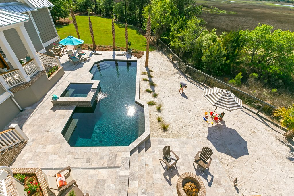 Pool With Fire Pit And Sandy Beach Area Aqua Blue Pools