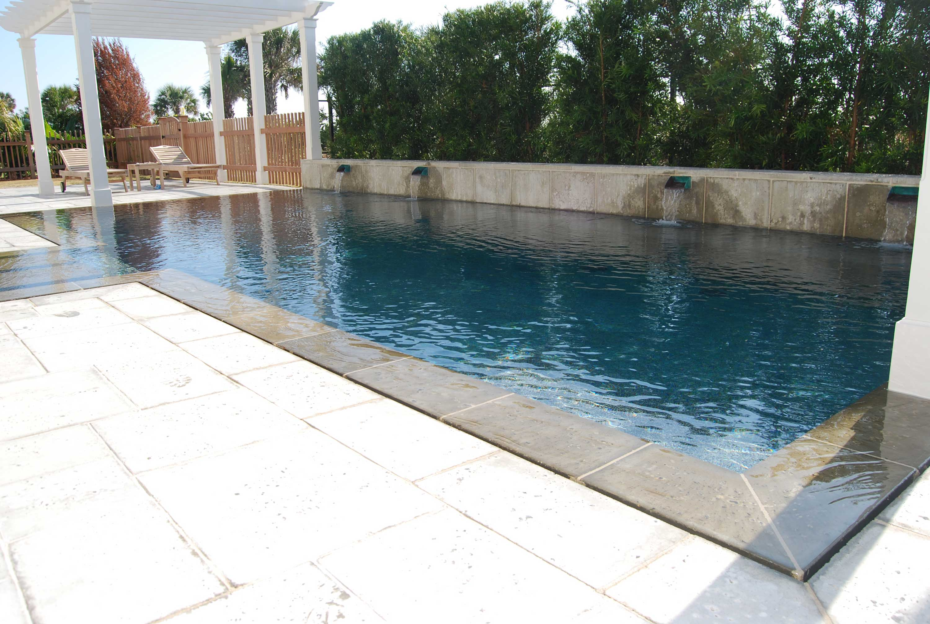 Perimeter overflow swimming pool and spa located on isle for Overflow pool design