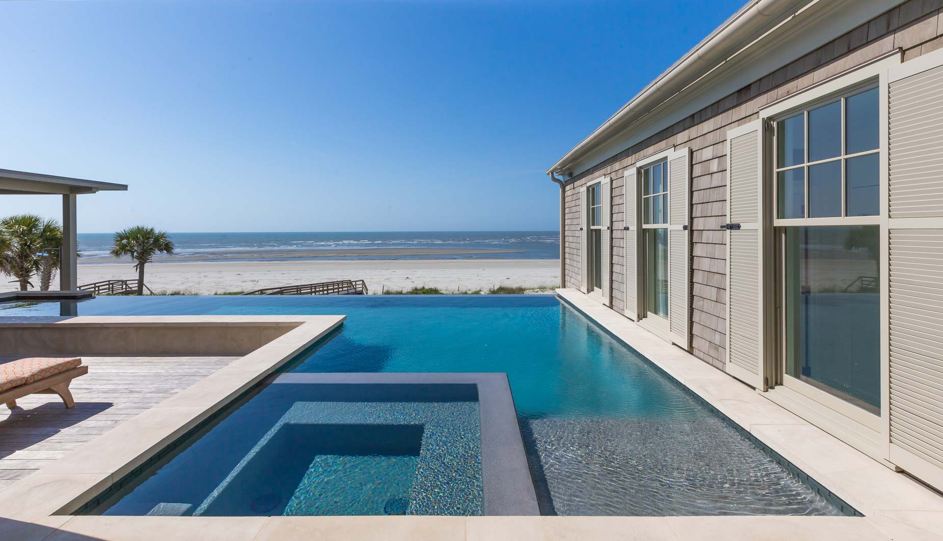 Infinity Pool Spa combo with scenic beach view and hydrazzo pool finish