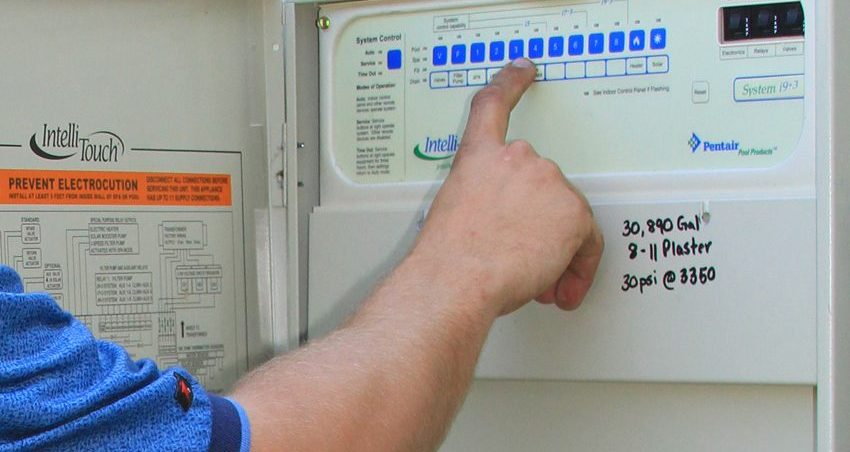 Hand pointing at a pool filtration system