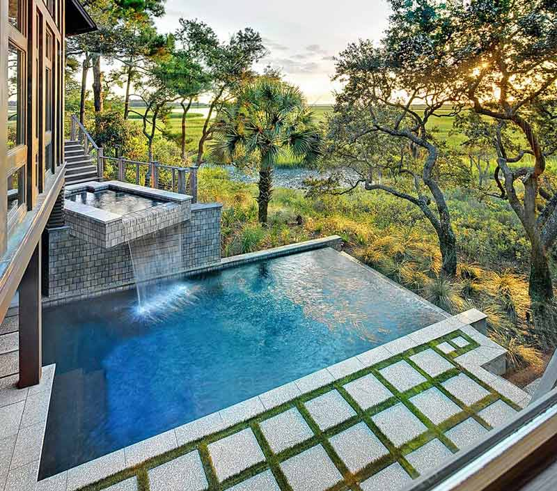 spa waterfall into plunge pool with view of marsh from kiawah island