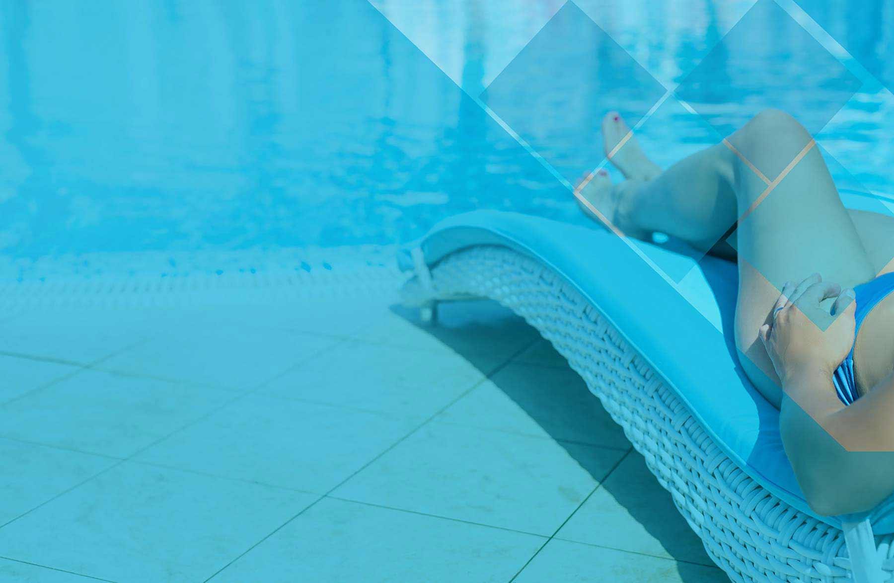 Woman legs sitting by pool