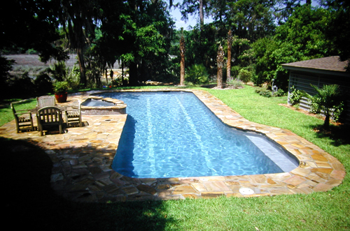 Attached Swimming Pool With Spa Combo In Backyard