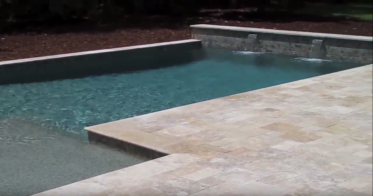 Geometric Swimming Pool With Water Features On Isle Of