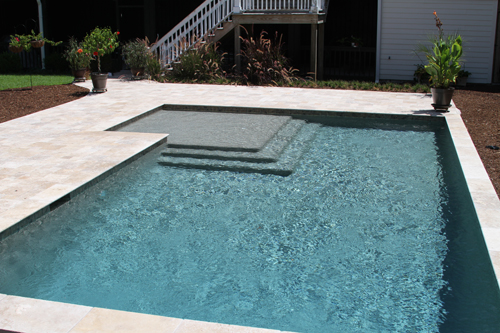 Geometric Swimming Pool With Sun Ledge And Umbrella Hole