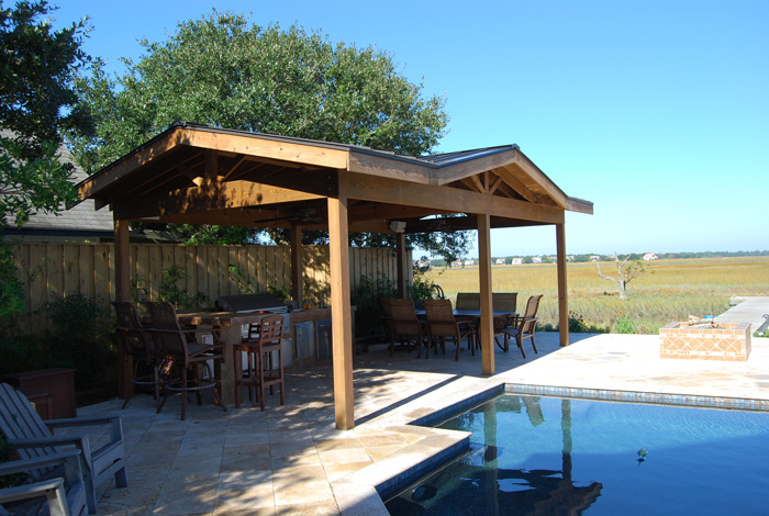 outdoor living space with gazebo covered kitchen and fire pit by