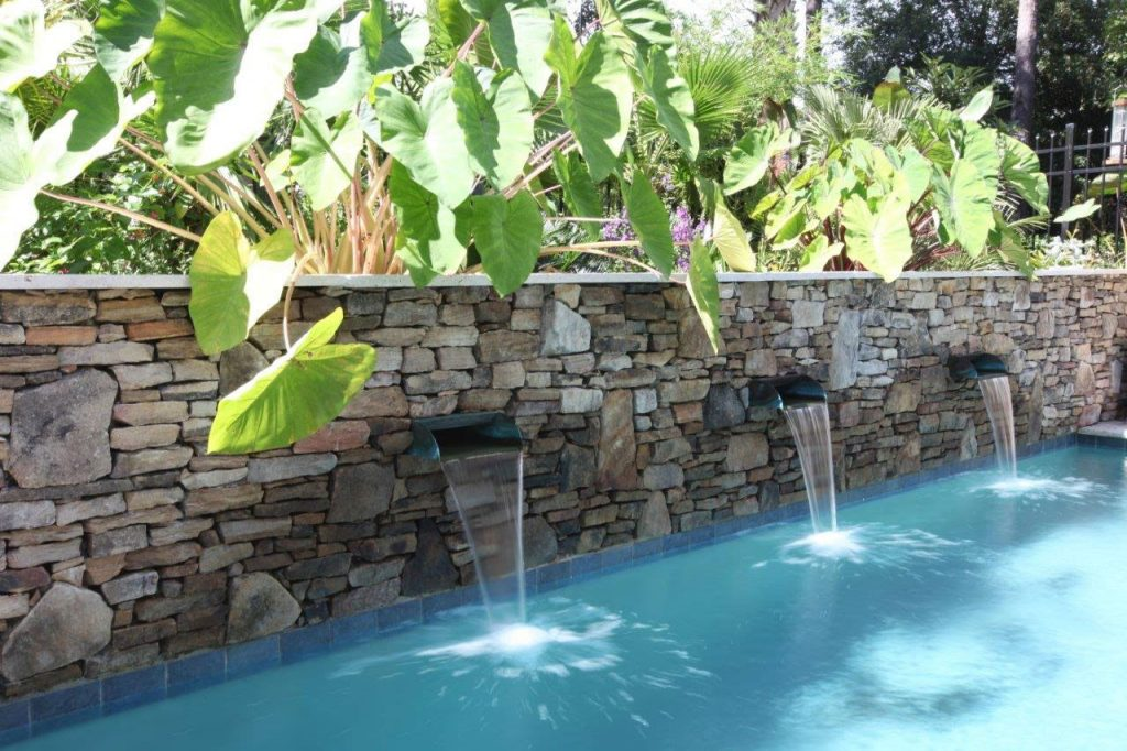 Pool With Spa And A Stone Wall With Waterfalls Aqua Blue