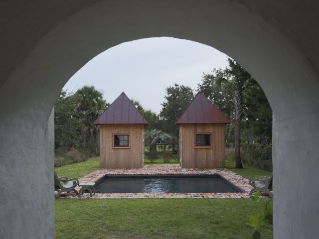 Geometric Inground Pool from arch view