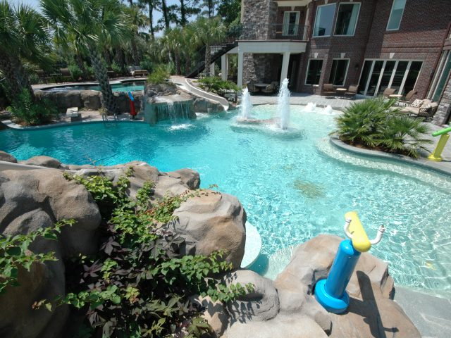 Luxury Swimming Pool with Custom Water Feature, Fountains and Slide