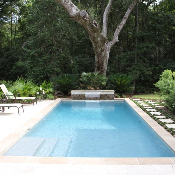 Geometric Pool with Steps and Custom Water Feature