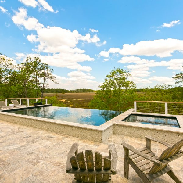 Custom Infinity Pool overlooking Trees in a Field Right View