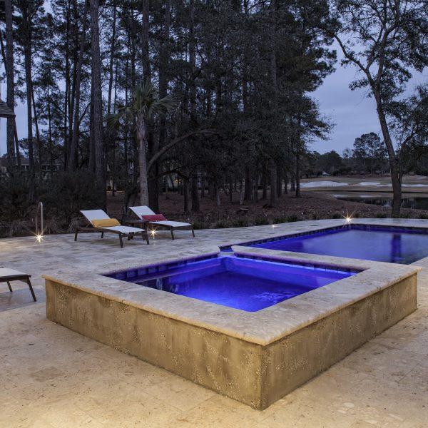Geometric Pool with Spa at Night with Custom Blue Lighting