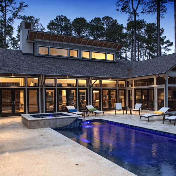 Custom Geometric Pool with Blue Lighting and Spa