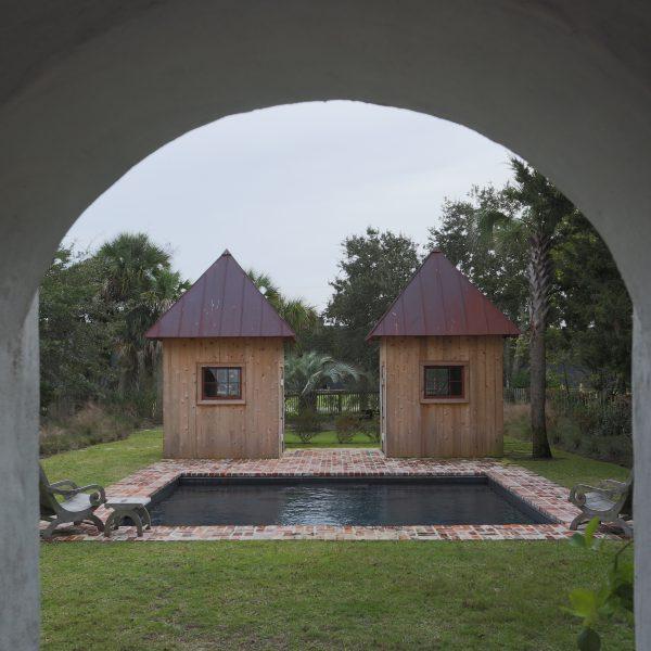Custom Inground Geometric Pool with Brickwork Surround Arch View