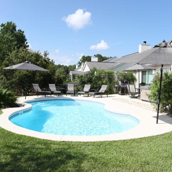 Family Backyard Fiberglass Pool Side View