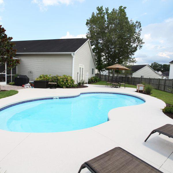 Freeform Fiberglass Backyard Pool Side View