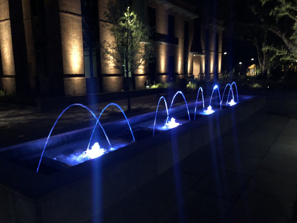 Luxury Water Fountains with Pool Lights at Night