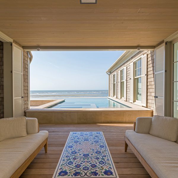 Overlooking an infinity pool by the beach
