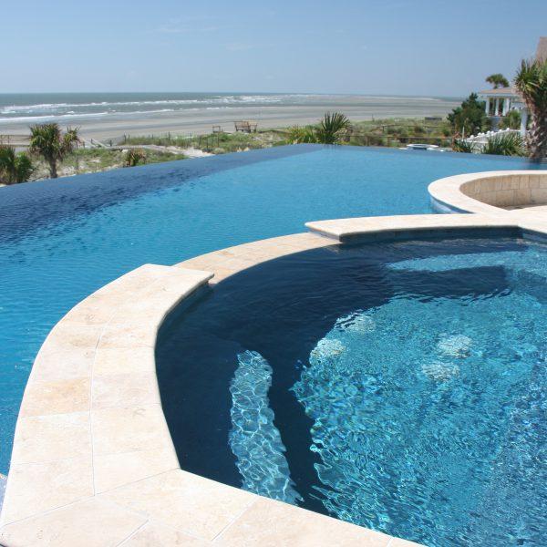 Infinity Pool with custom spa overlooking the beach