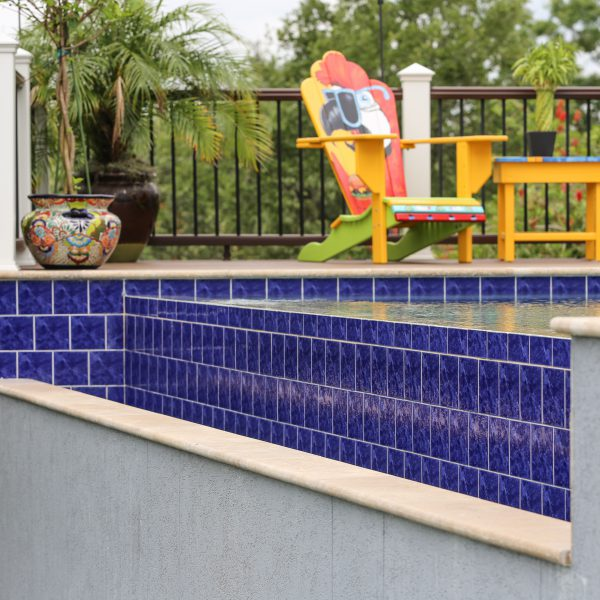 Blue tiled detailing for an Infinity Pool back wall
